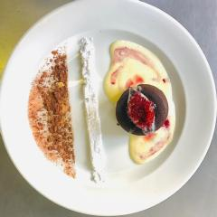 Chocolate fondant, crème anglaise and berry coulis