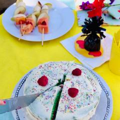 Avas emoji rainbow cake topped with rasberries